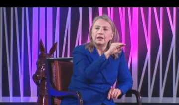 clinton pats india for reduction in iranian oil...