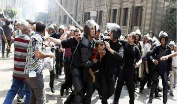 egyptian riot police fire tear gas at protesters...