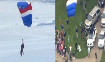 former us president george bush skydives on 90th...