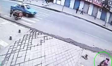 girl on phone accidentally falls through hole in...