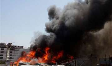 helicopters rescue residents from favela fire -...