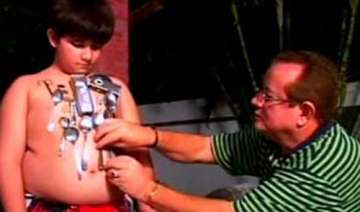 human magnet brazil boy attracts metal objects to...