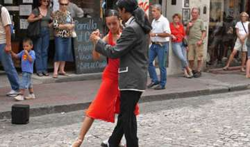 hundreds of couples tango on streets of buenos...