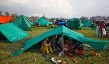 nepal sleeps out in open as aftershocks spread...