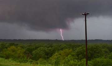 over 70 tornadoes kill five in us eight missing -...