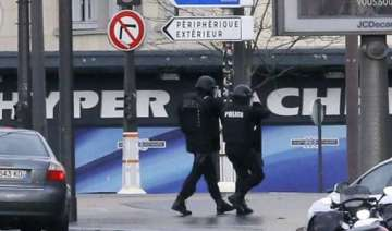 police gunman to kill hostages if police storm...