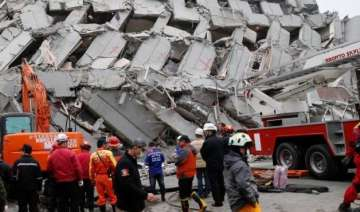 survivors pulled out from building 2 days after...
