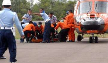 airasia crash 10 more bodies brought to hospital...