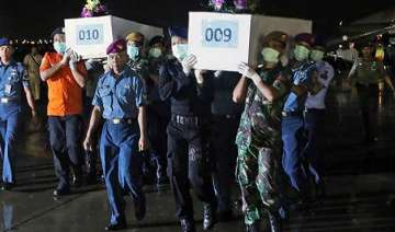 some airasia victims found belted in seats -...