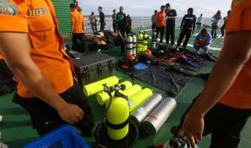 airasia qz8501 search teams find two large...