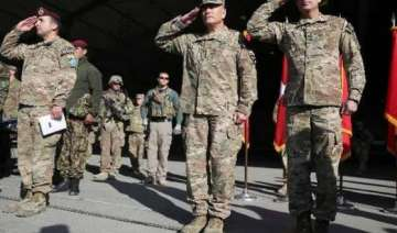 us nato ceremonially end afghan combat mission -...