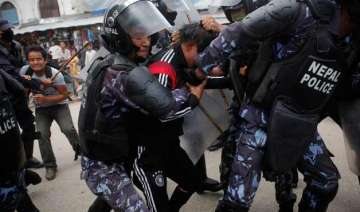 pro statehood protesters attack police in west...