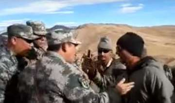 china plays down indian border standoff watch...