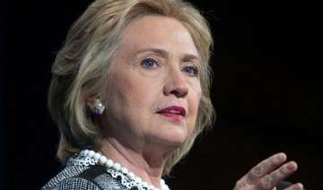 hillary clinton fights back as republicans mount...