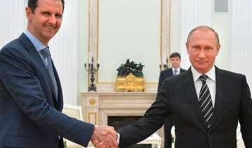 syrian president assad travels to moscow meets...