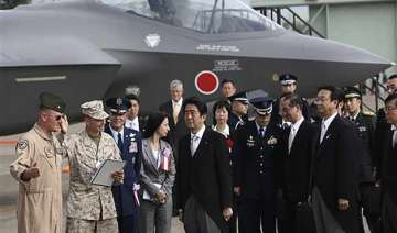 japan cabinet okays record military budget with...