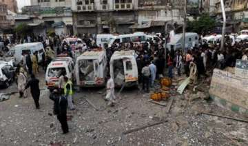 suicide bombing at shiite procession kills 20 in...