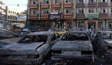 24 killed in two suicide attacks in baghdad -...
