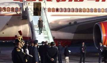 pm modi lands in paris to push make in india...