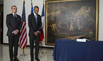 obama pays respects at french embassy after paris...