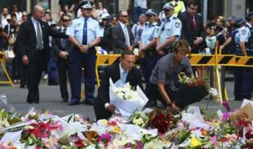 australian pm lays flowers at siege site - India...