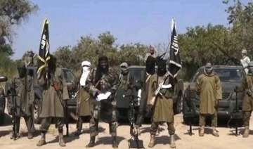 boko haram militants kill woman while she was in...