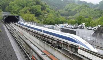 japan s maglev train breaks own speed record at...