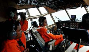 airasia crash search to continue with waves...