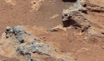 mars pebbles travelled 50 km down a riverbed...