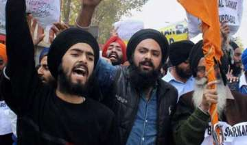 sikh americans condemn desecration of sikh holy...