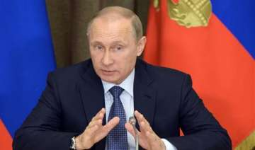 vladimir putin signs russian law to shut...