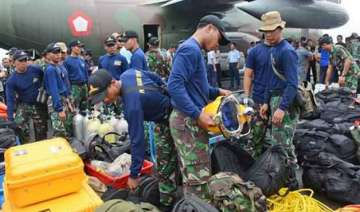 divers being sent to examine airasia wreckage -...