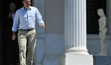 greece s pm alexis tsipras quits calls early...
