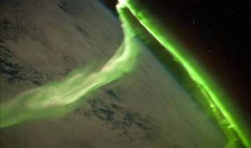 stunning green glow of southern lights as seen...