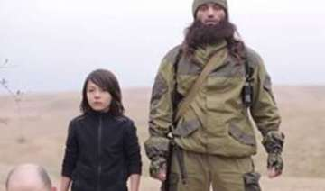 isis video shows child executing two russian...