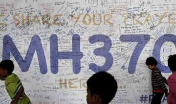 mh370 mystery more suspcted wreckage found -...