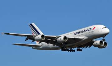 air france jet escorted by us fighters after...