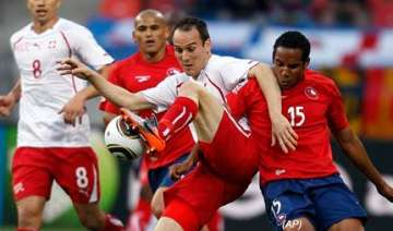 chile beat 10 man switzerland to close in on last...