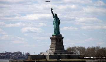 statue of liberty evacuated after bomb threat -...