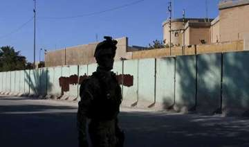 iraq builds security wall around baghdad to...