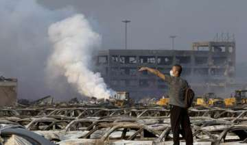 fire continues to rage in china as death toll...