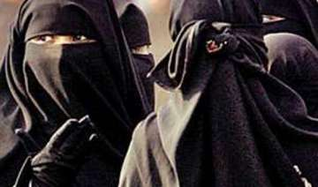 chinese city in restive muslim region bans burqa...