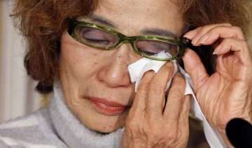 mother of is held japanese hostage calls for...