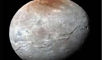 nasa releases pluto s moon charon in eye catching...