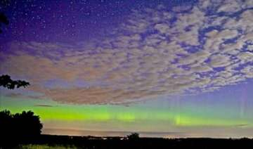 solar storm hits earth causing spectacular aurora...