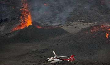 highly active volcano erupts on reunion amid...