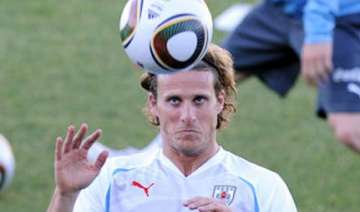 forlan powers uruguay past south africa - India TV