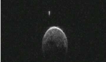 asteroid that flew past earth has small moon -...