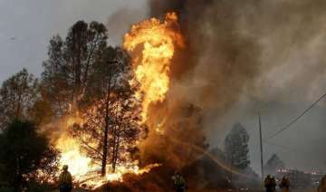cooler weather helps crews battling california...