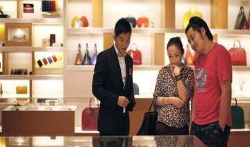 china buys half of all luxury goods report -...